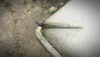 High Angle View Of Marijuana Joint On Table
