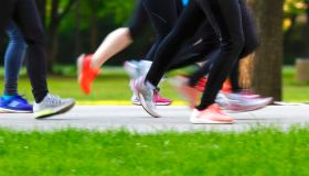 Low Section Of Women Running On Footpath