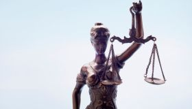 Lady Justice against blue background