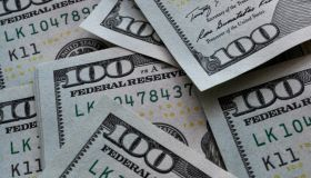 In this photo illustration one hundred US dollar banknotes...