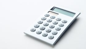 Electronic Gray Calculator Isolated On A White Background. Banner.